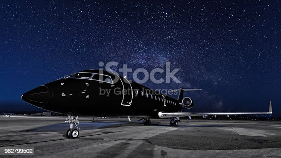 istock business jet. black plane is parked 962799502