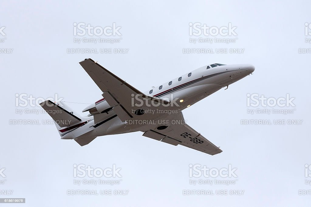 Business jet climbing after take off stock photo