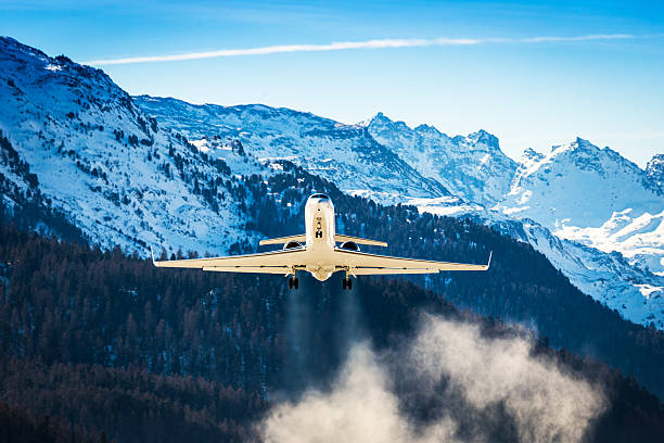 Business Jet departing a snowy airfield stock photo