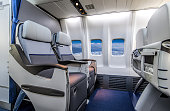 Empty business class airplane cabin with no passengers inside