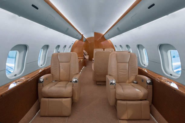 Business jet interior Business jet cabin with leather seats vehicle seat stock pictures, royalty-free photos & images