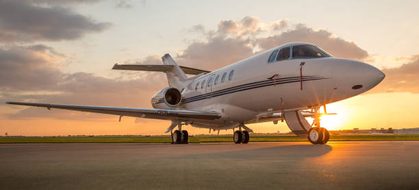 Business Jet on Ramp with Sun in Background stock photo