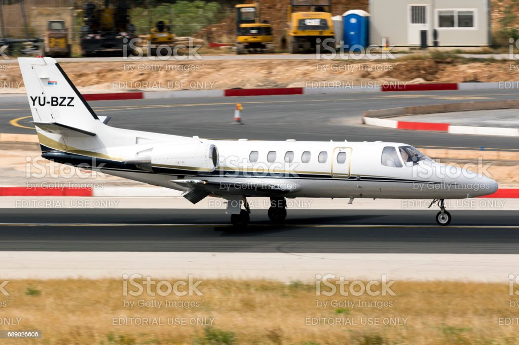 Business Jet slowing down on landing stock photo