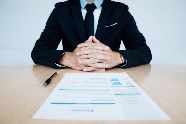 business job interview. hr and resume of applicant on table. - job search stock photos and pictures