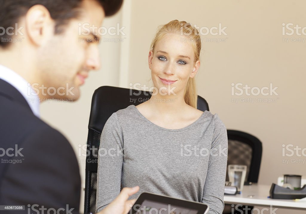 Business - Job Interview Young woman sitting in job interview 20-24 Years Stock Photo