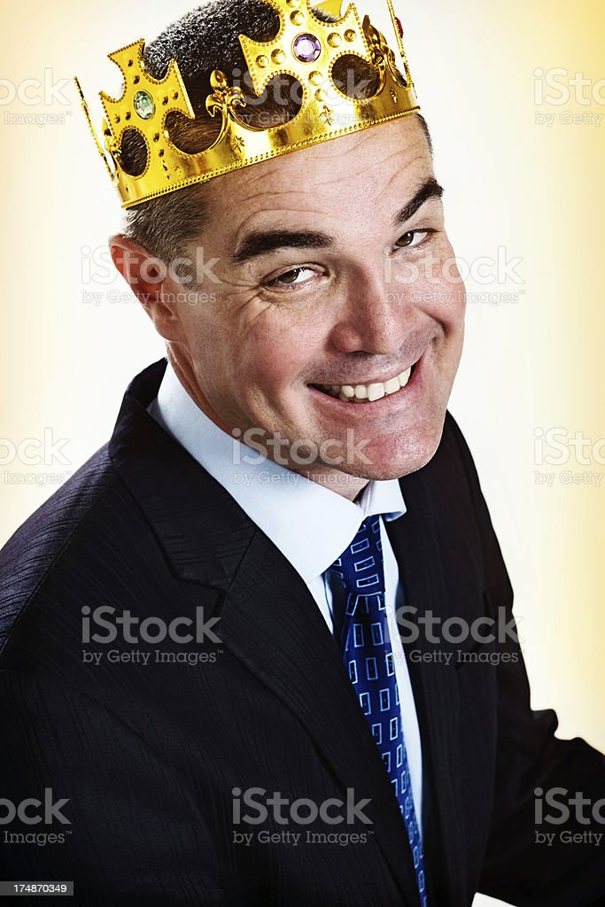 Business kingpin smiles in delight: he is a success stock photo