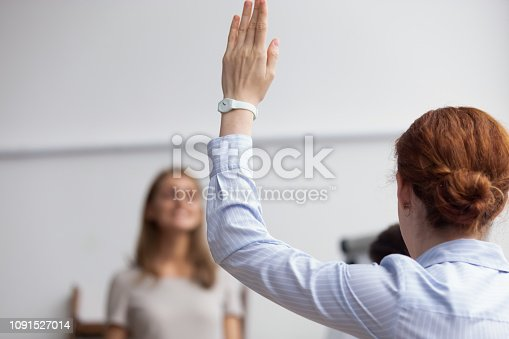 istock Business lady raise hand voting during business meeting 1091527014