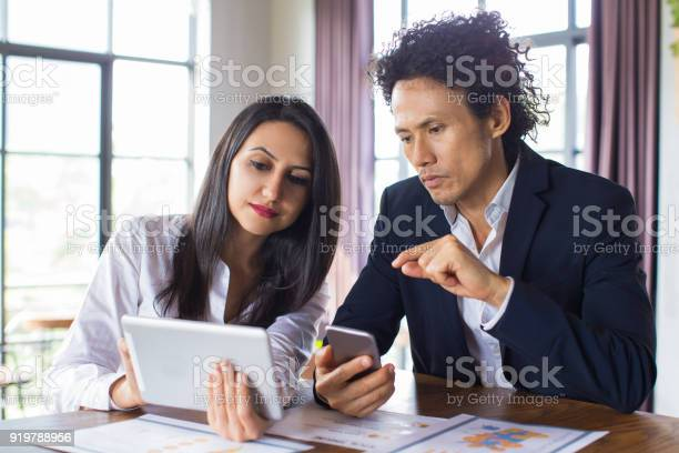 Business Lady Showing Her Idea To Investor Stock Photo - Download Image Now