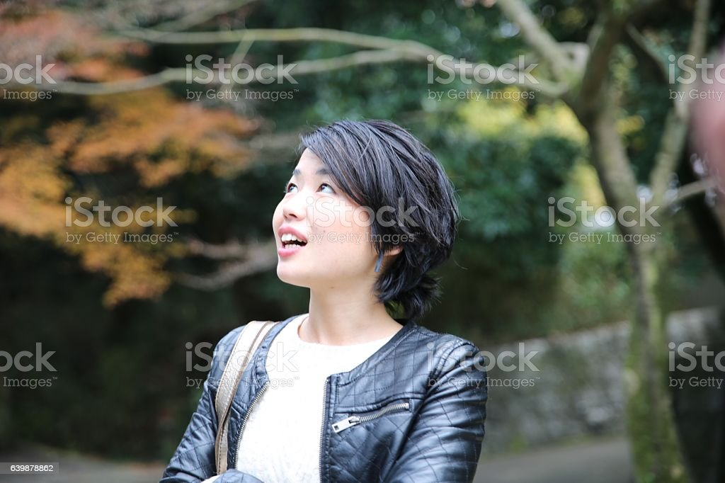 Business lady walking at Sanmon area of Tofuku temple stock photo