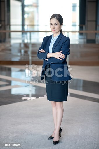 Appealing young successful businesswoman feeling excited and motivated