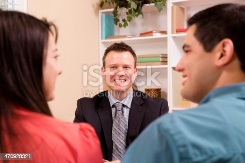 1129638619 istock photo Business: Latin couple meets with their financial advisor. 470928321
