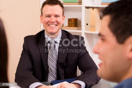 1129638619 istock photo Business: Latin couple meets with their financial advisor. 470928323