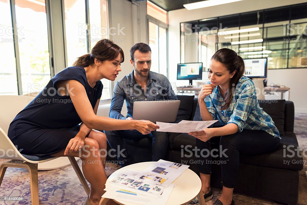 Business leader woman working with her team in startup stock photo