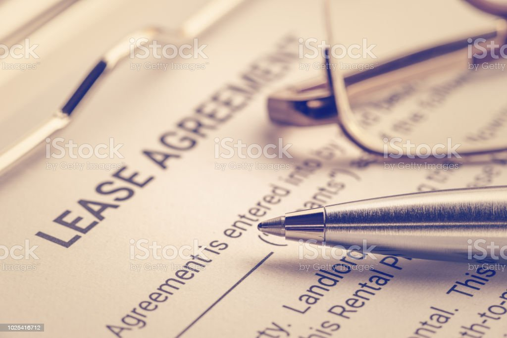 Business Legal Document Concept Pen And Glasses On A Lease Agreement