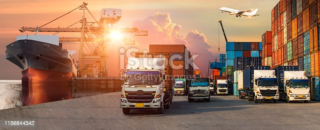 istock Business Logistics and transportation concept of Container Cargo ship and Cargo plane with working crane bridge in shipyard, logistic import export and transport industry background 1156844342