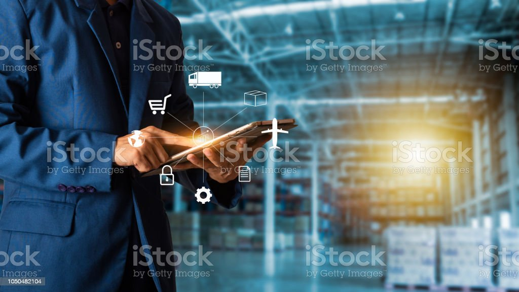 Business Logistics concept, Businessman manager touching icon for logistics on  Modern Trade warehouse background. Industry 4.0 concept Business Logistics concept, Businessman manager touching icon for logistics on  Modern Trade warehouse background. Industry 4.0 concept Adult Stock Photo