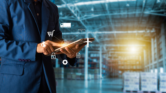 Business Logistics Concept Businessman Manager Touching Icon For Logistics On Modern Trade Warehouse Background Industry 40 Concept Stock Photo - Download Image Now