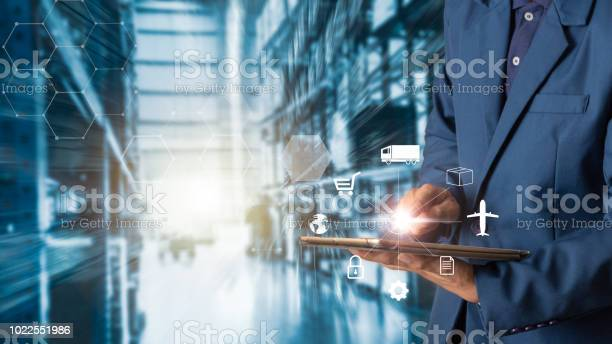 Business Logistics Concept Businessman Manager Using Tablet Check And Control For Workers With Modern Trade Warehouse Logistics Industry 40 Concept Stock Photo - Download Image Now