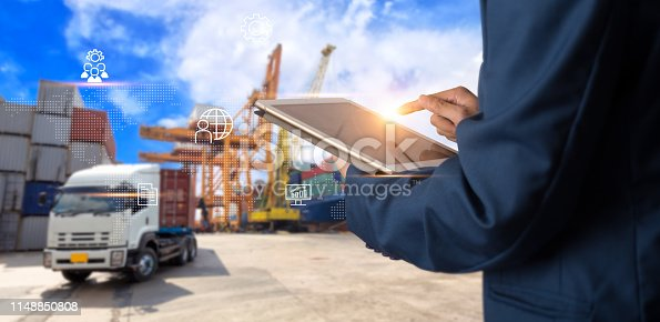 istock Business Logistics concept, Businessman manager using tablet check and control for workers with Modern Trade warehouse logistics. Industry 4.0 concept 1148850808
