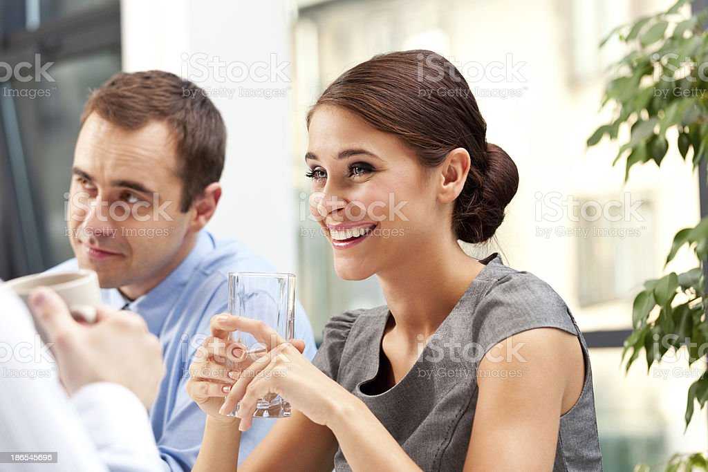 Business lunch Cheerful business people having a lunch break.  Adult Stock Photo
