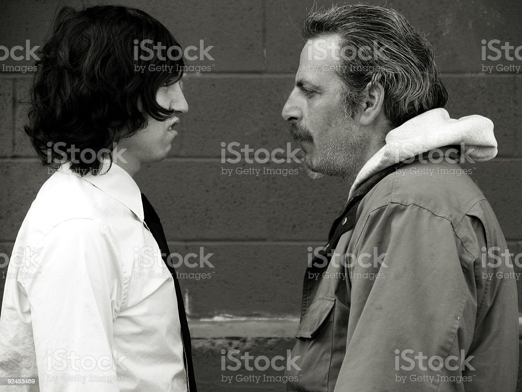 Business Male and Homeless Man Making Gross Faces royalty-free stock photo