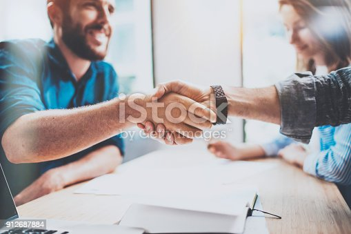 istock Business male partnership handshake concept.Photo two mans handshaking process.Successful deal after great meeting.Horizontal, blurred background. 912687884