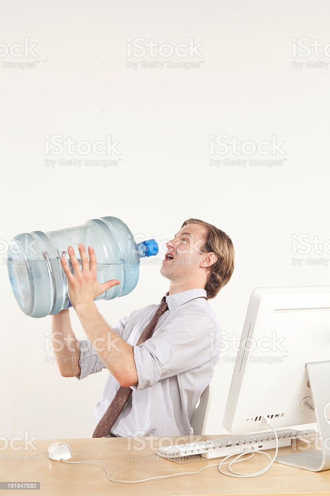 Business man about to drink water stock photo