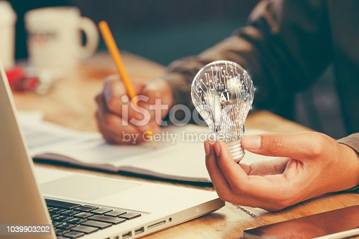 istock business man accountant holding light bulb, new idea with innovation concept 1039903202