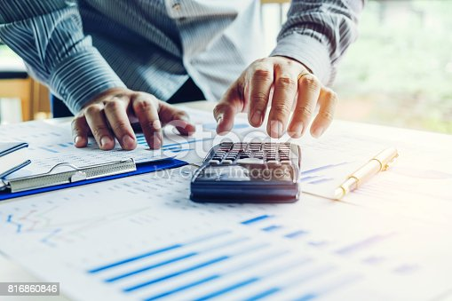 istock Business man Accounting Calculating Cost Economic 816860846