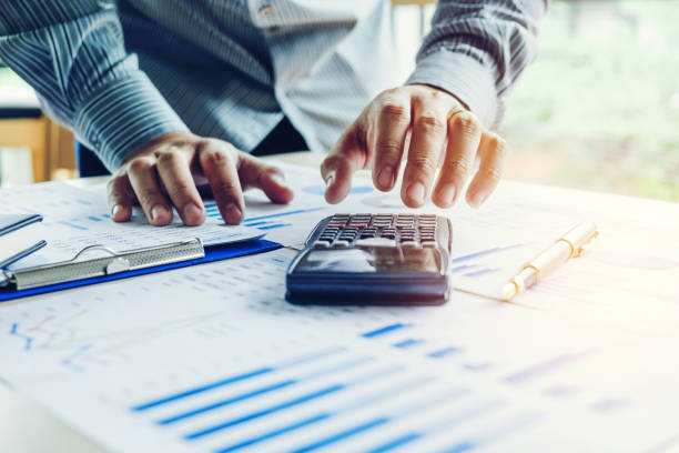 Business man Accounting Calculating Cost Economic stock photo