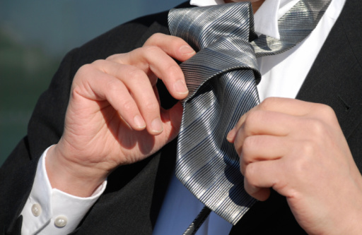 516141885 istock photo business man adjusting his tie 95491792