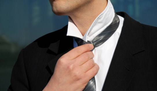 516141885 istock photo business man adjusting his tie 95491793
