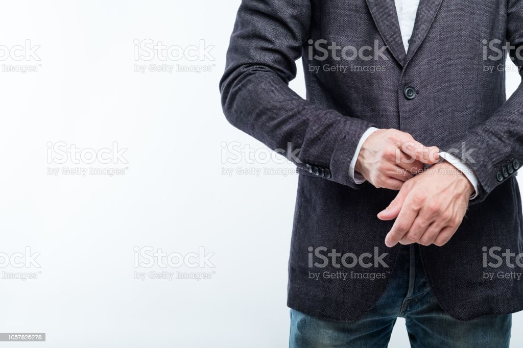 business man adjusting sleeve success confidence stock photo