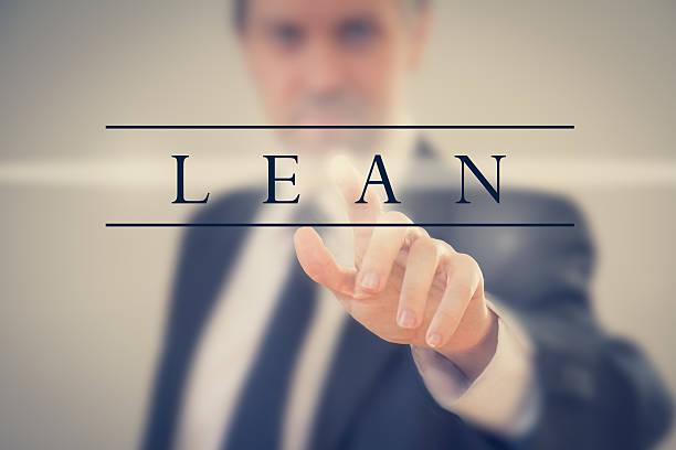 business man adopting lean methodology - appoggiarsi foto e immagini stock