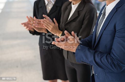 924520168 istock photo business man and business woman clap their hands to congratulate the signing of an agreement or contract between their firms, companies, enterprises. success, dealing, greeting and partner concept. 881953276