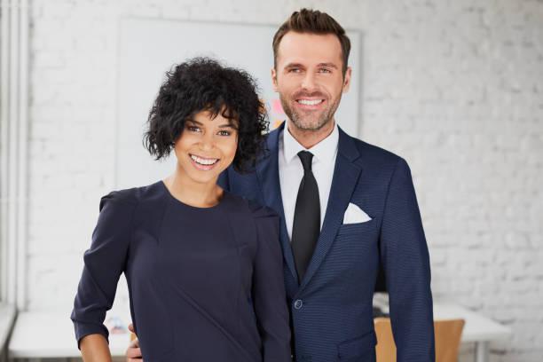 Business man and business woman standing together in the office picture id937352014?b=1&k=6&m=937352014&s=612x612&w=0&h=ew owjqgsq3j7y9i823xwf56 riote b3uth trcioc=
