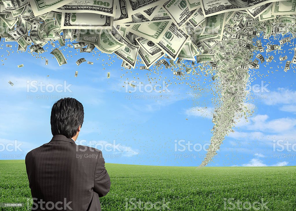 business man and money storm stock photo
