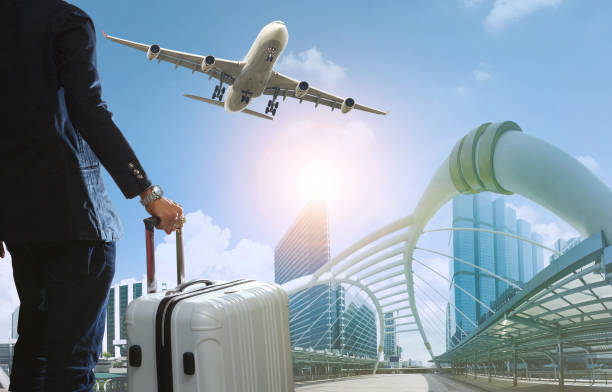business man and traveling luggage in city life with plane flying over skyscraper business man and traveling luggage in city life with plane flying over skyscraper flight suit stock pictures, royalty-free photos & images