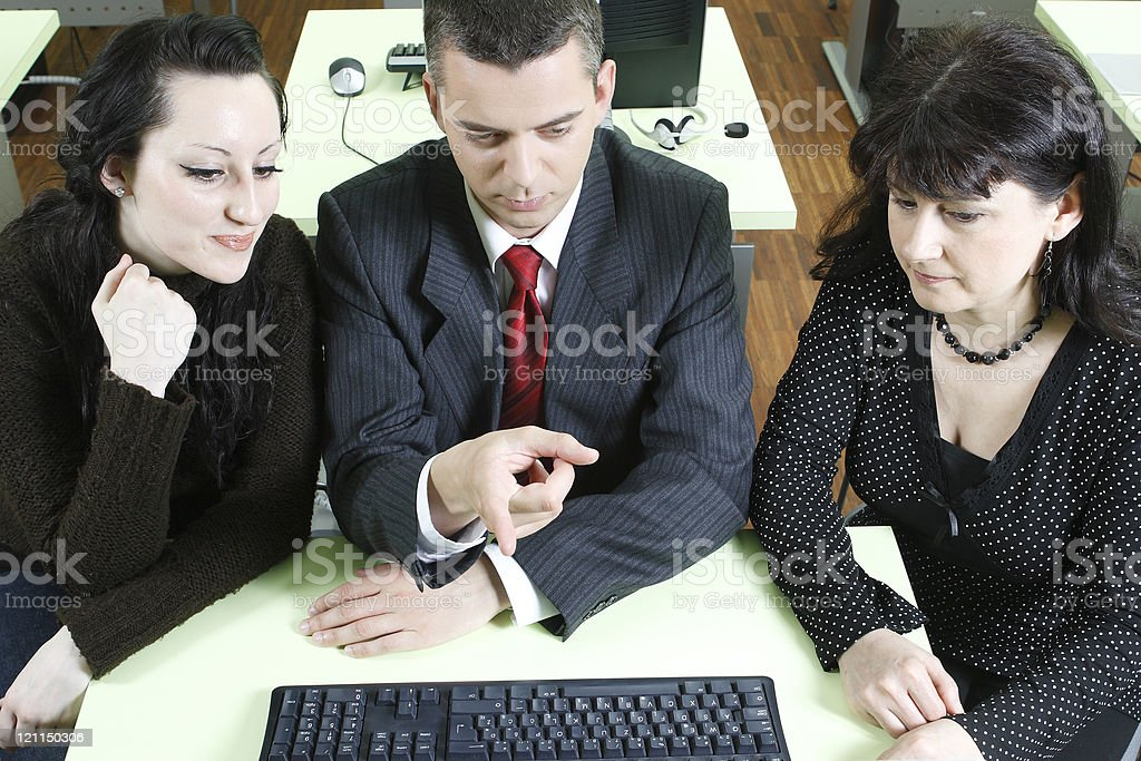Business Man and two women looking at the screen stock photo