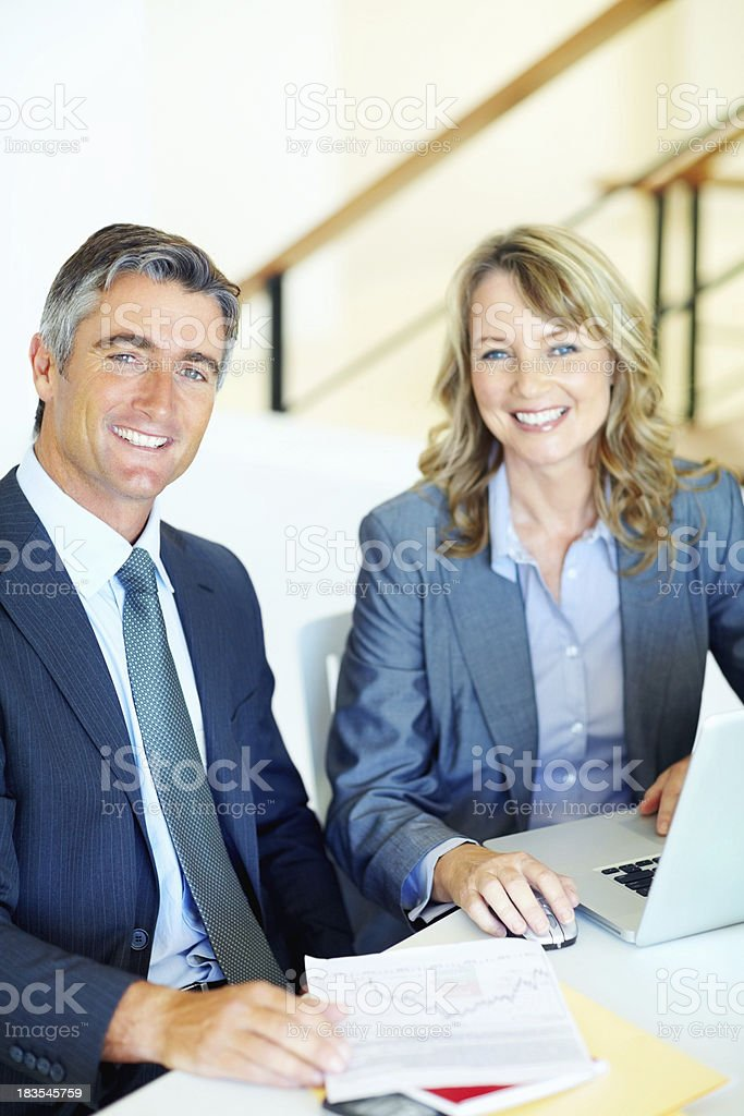 Business man and woman at desk royalty-free stock photo