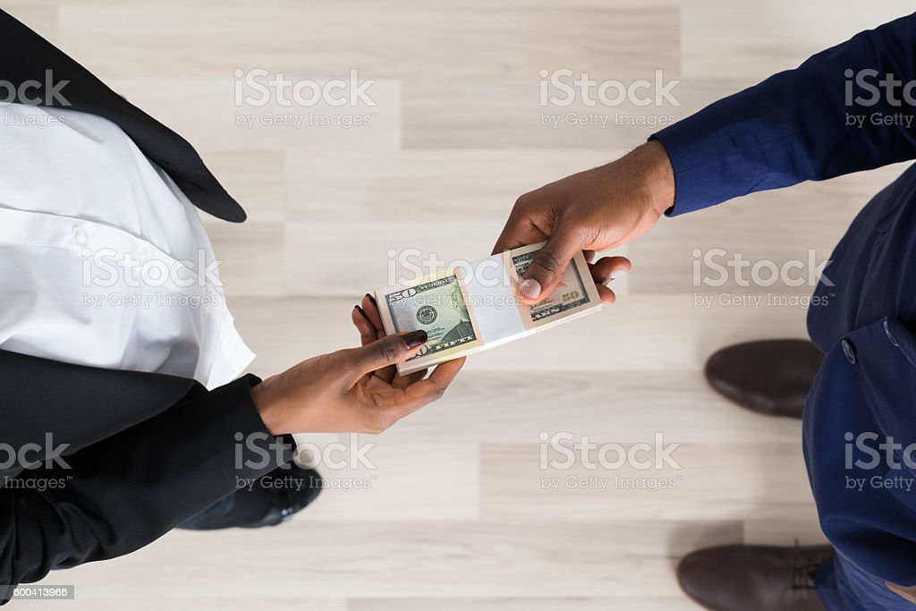Business Man And Woman Exchanging Money stock photo