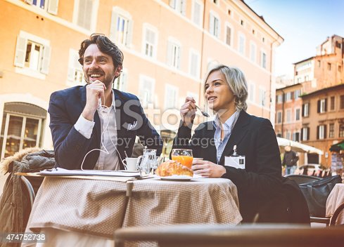 istock Business man and woman having breakfast 474752738
