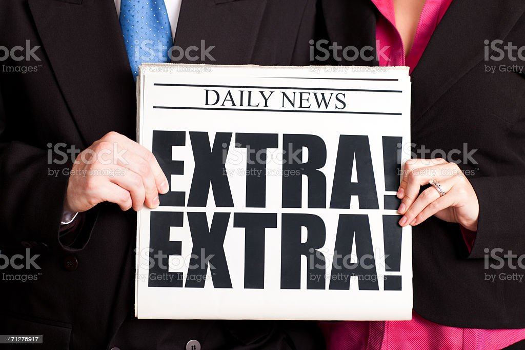 Business Man and Woman Holding Extra! Headline Newspaper royalty-free stock photo