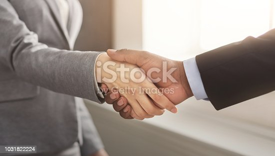 istock Business man and woman shaking hands 1031822224