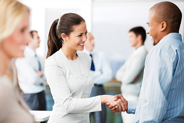 Business man and woman shaking hands. stock photo