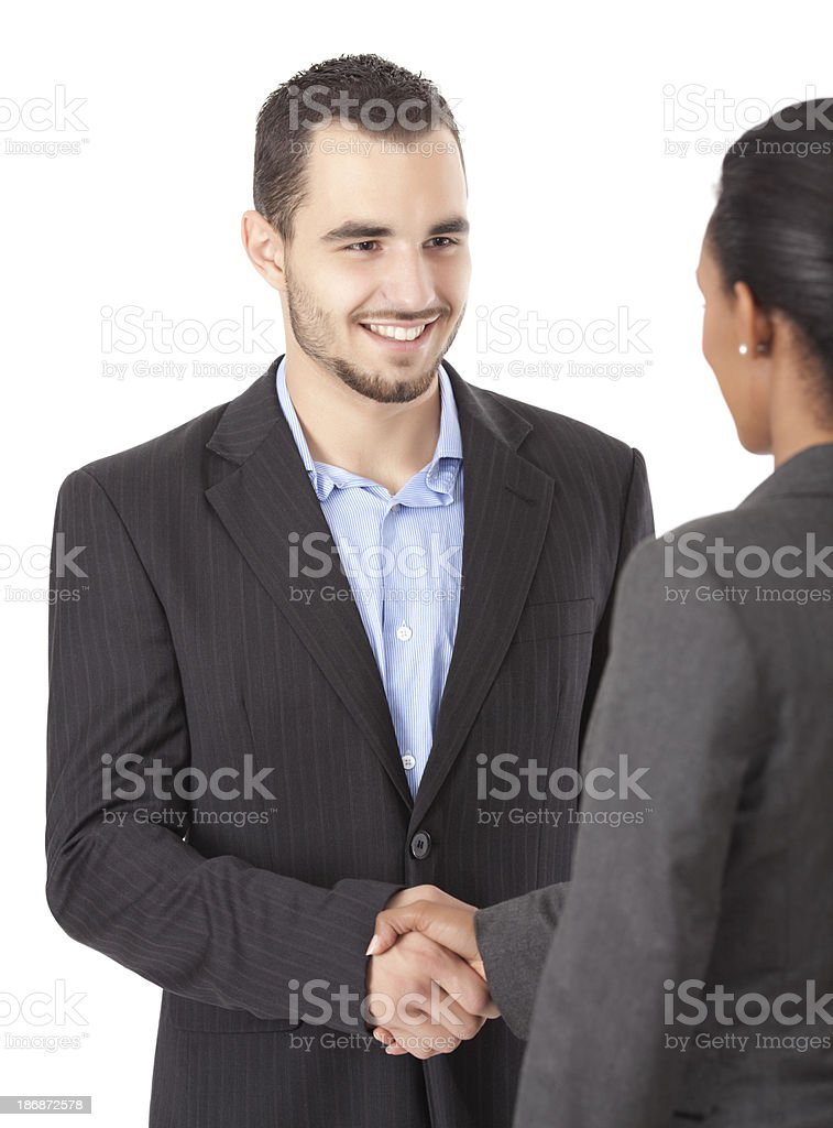 Business man and woman shaking hands. royalty-free stock photo