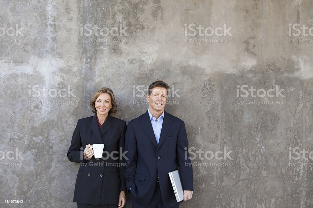 Business man and woman smiling stock photo