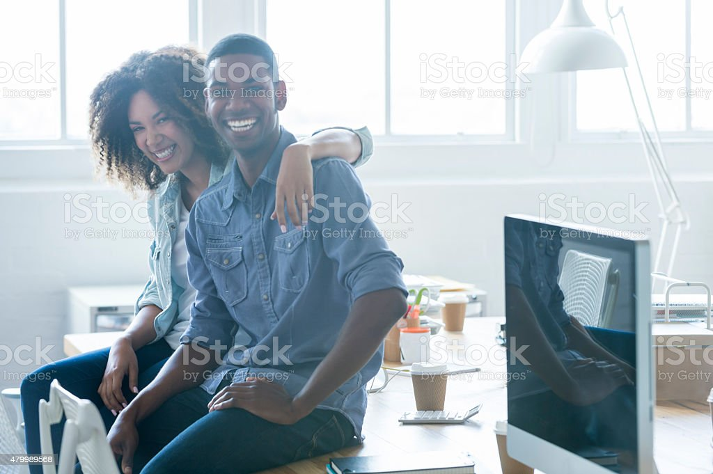 Business man and woman taking in an office. stock photo