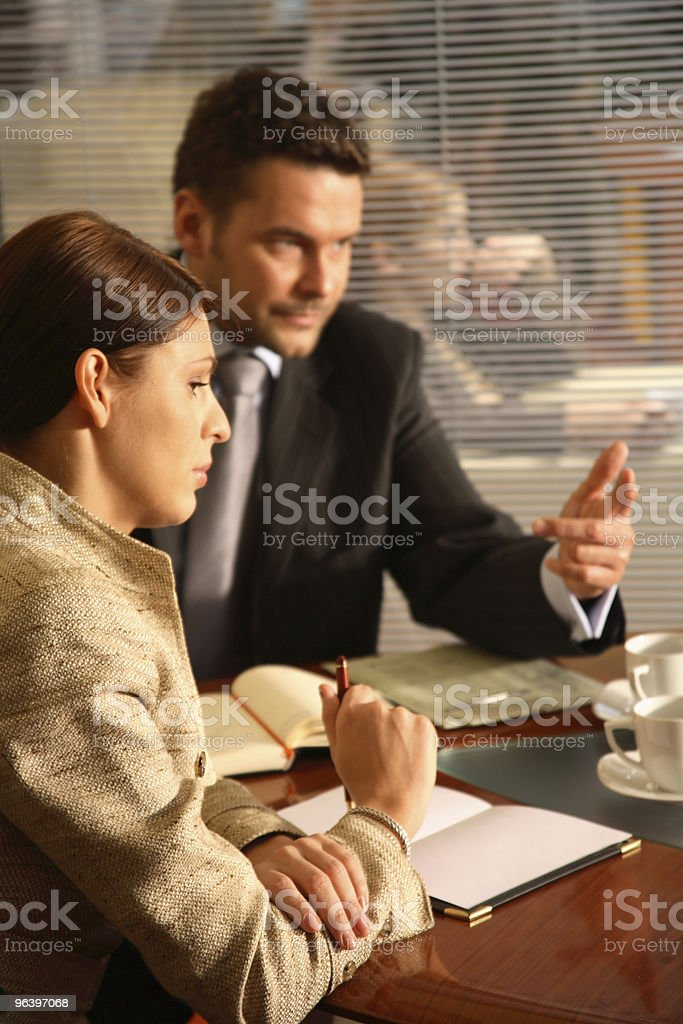 Business man and woman talking in the office - Royalty-free Adult Stock Photo