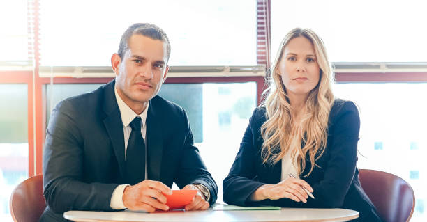 Business man and woman using a digital tablet and having a meeting, coworkers stock photo
